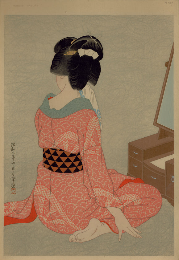 "Hirano Hakuhō: ""Woman Before A Mirror"". A seated beauty in a pink robe holds a towel to her face as she sits before a mirror."