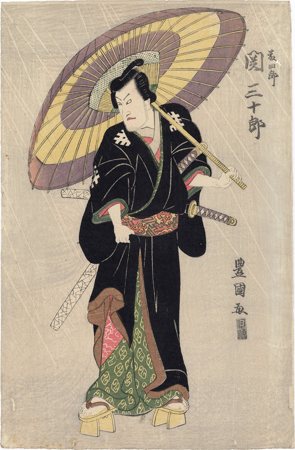 Toyokuni I: Seki Sanjûrô II with Umbrella in the Rain