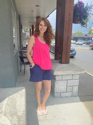 Donna in Papa tank and TB shorts