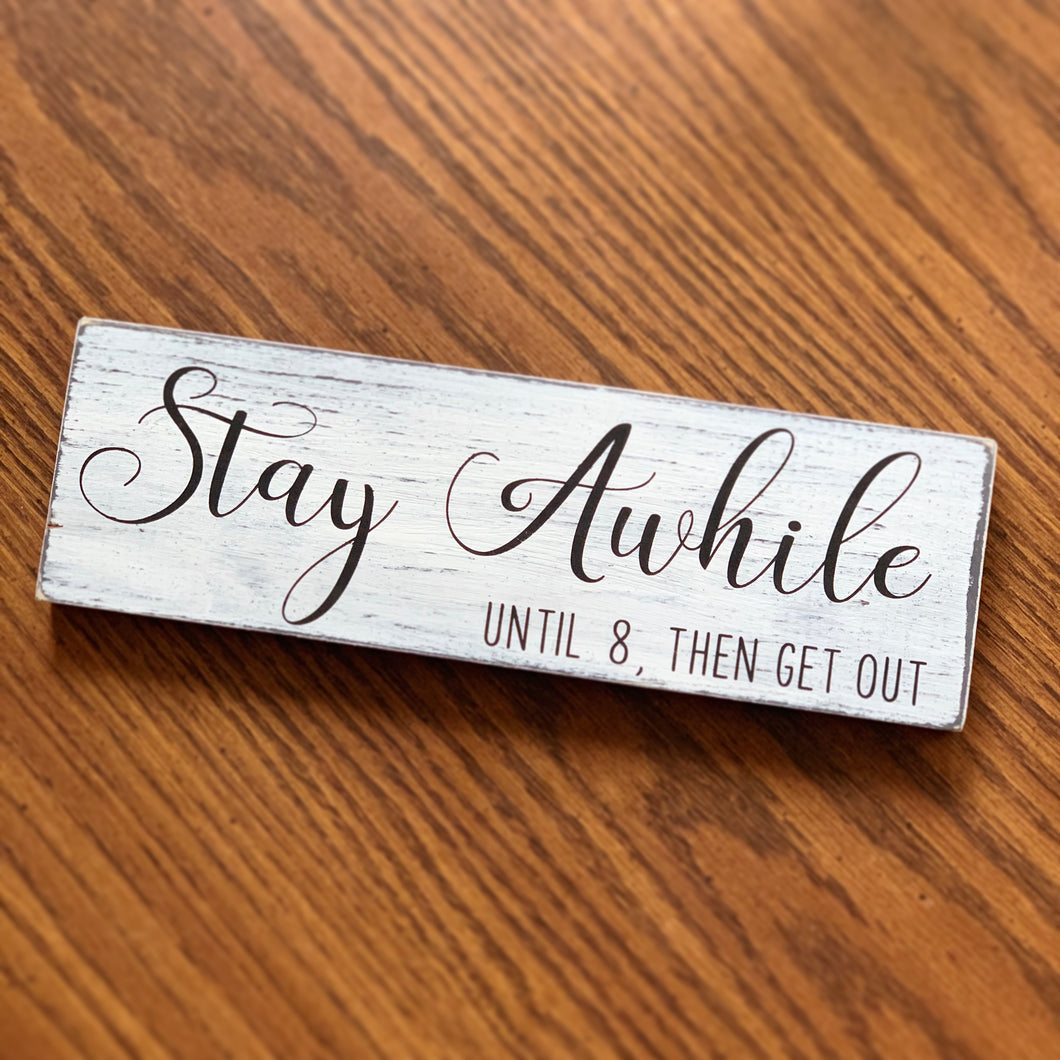 Stay Awhile and Get out sign