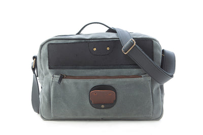 Our William Ross weatherproof travel bag has a front pocket has a zipper closure with a leather flap held down by a pin closure.