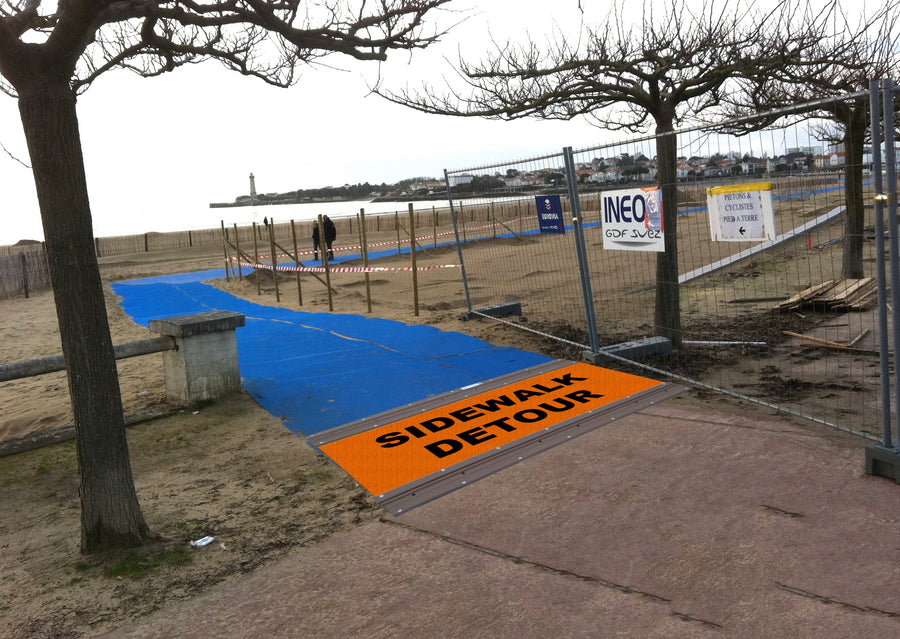 Photograph of a blue Mobi - Path / Roadway that  is being used  a temporary footpath at a building / construction area to keep people safe and out of dangers way.