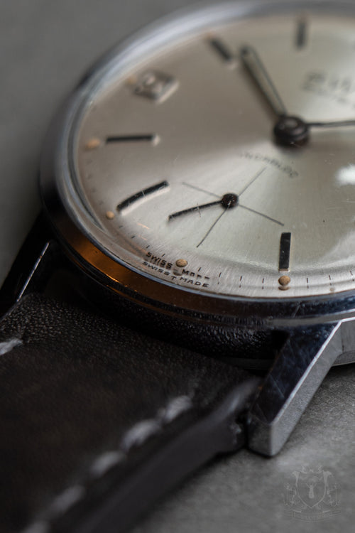 BWC silver sunburst dial and date function