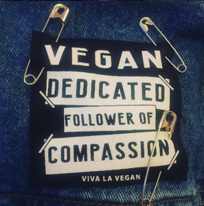 Tygmärke: Vegan - decicated follower of compassion