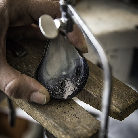 Anette Skaugen Guldager cuts out only the strongest and best parts of the oyster for her jewelry.