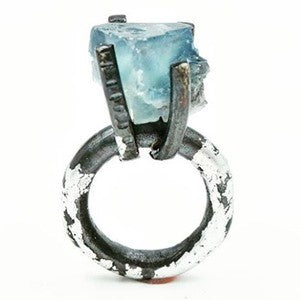 Blackened Sterling silver ring, set with rough blue Fluorite and silver leaf by Jill Herlands.