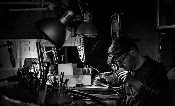 Tomasz Kargul - a goldsmith and jewelry designer - works with precision tools at his workshop.