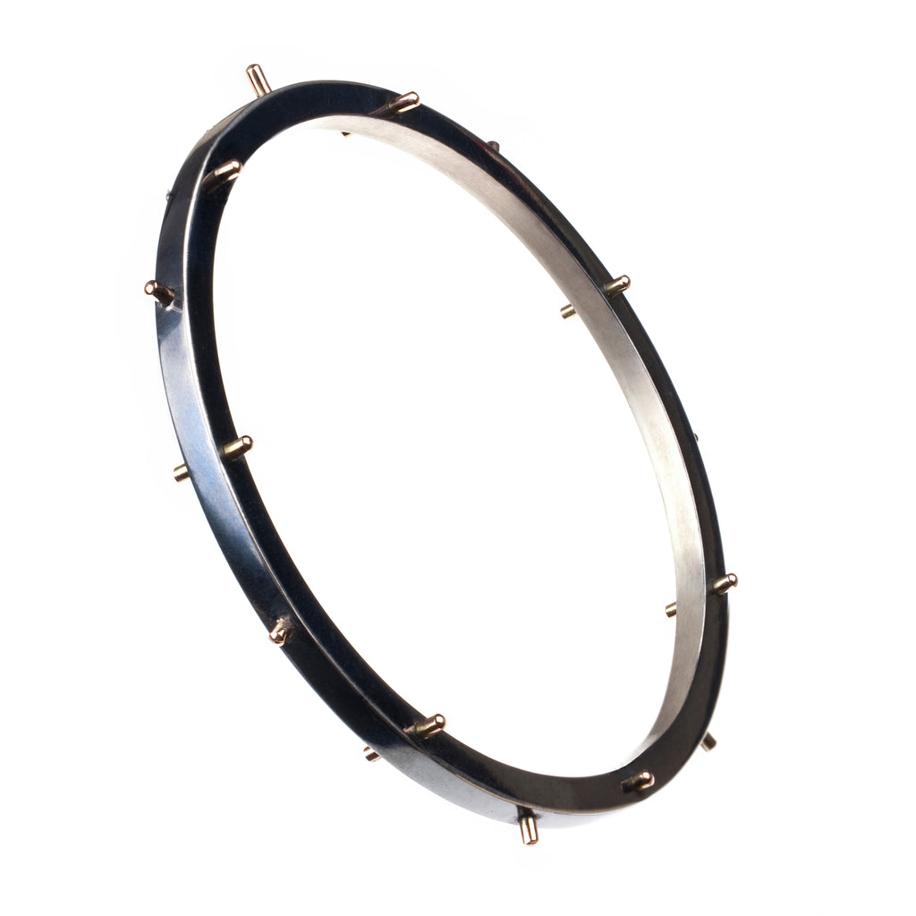 The ANADEMA CLAVUS bangle (bracelet) by Undlien design. Hanne Undlien is a Norwegian jewelry designer in Oslo, Norway.