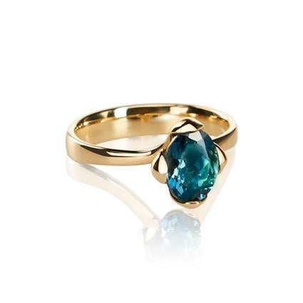 The Honey Petal Ring by Vlad Kladko of Vido Jewels, made with 14K gold and London blue Topaz.