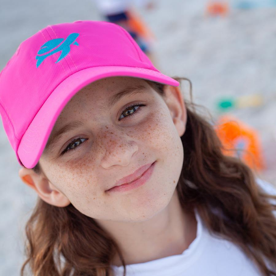 Girl wearing Turtle Classic Kids on beach