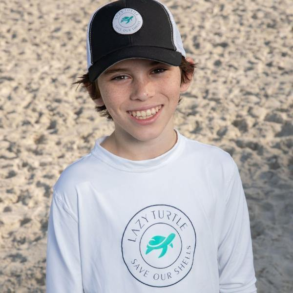 Boy wearing Paddle Sun Safe Long Sleeve