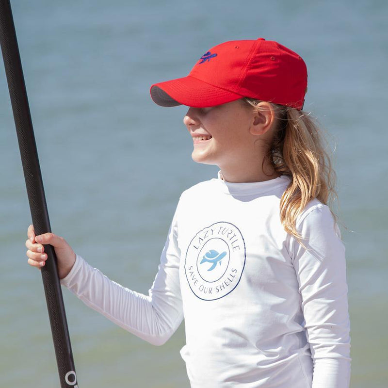Side view of girl wearing Turtle Classic Kids on paddleboard