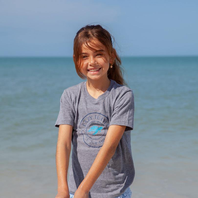 Girl on beach wearing Juju Tee
