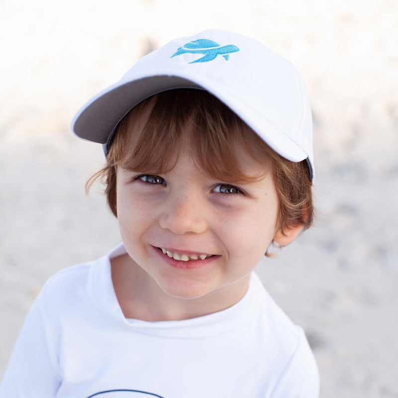 Boy wearing Turtle Classic Kids on beach