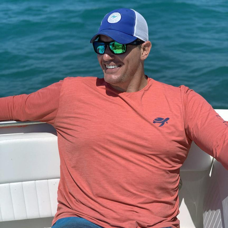 Man wearing Ocean Sun Safe Long Sleeve on boat