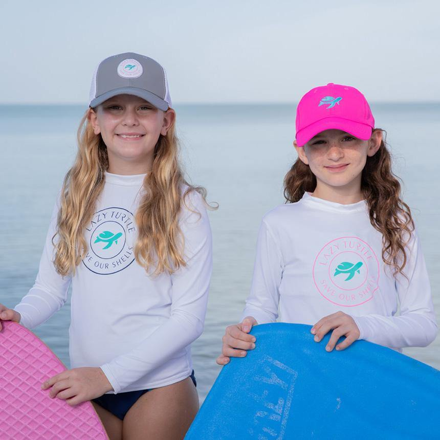 Two girls wearing Paddle Sun Safe Long Sleeve on beach