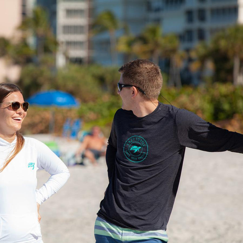Man wearing Coastal Sun Safe Long Sleeve talking with woman
