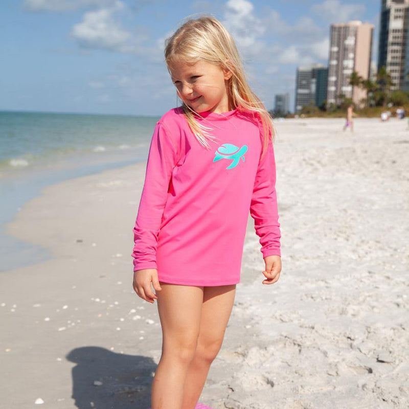 Girl wearing Sand Castle Sun Safe Long Sleeve on beach