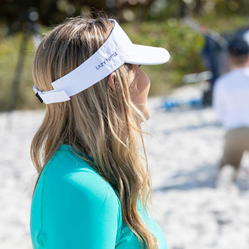 Side view of woman wearing Turtle Visor on beach