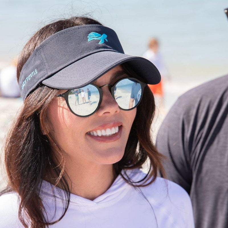 Woman wearing Turtle Visor on beach