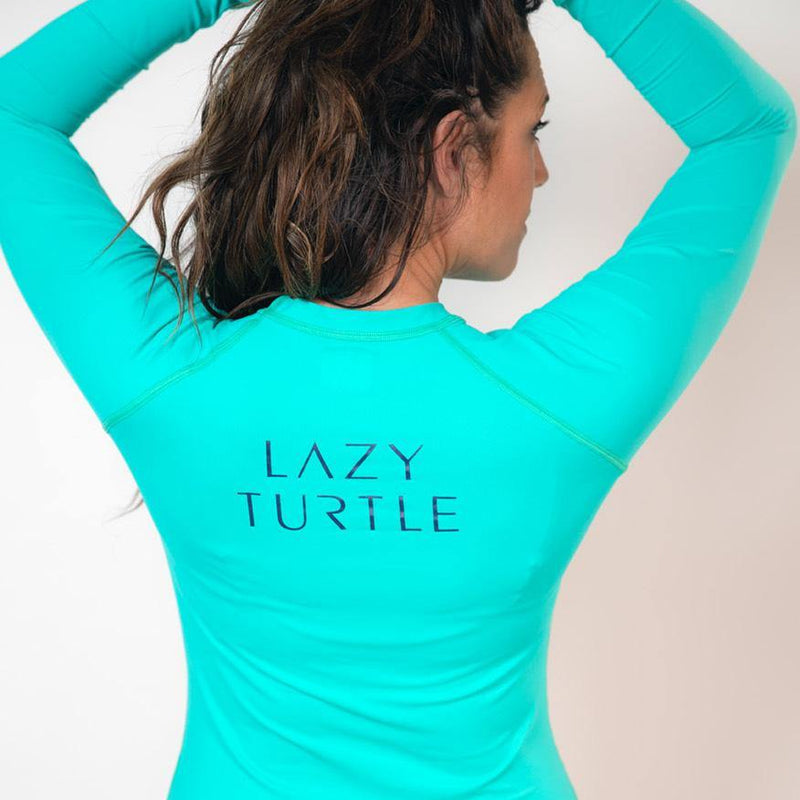 Back view of woman wearing Wave Sun Safe Long Sleeve