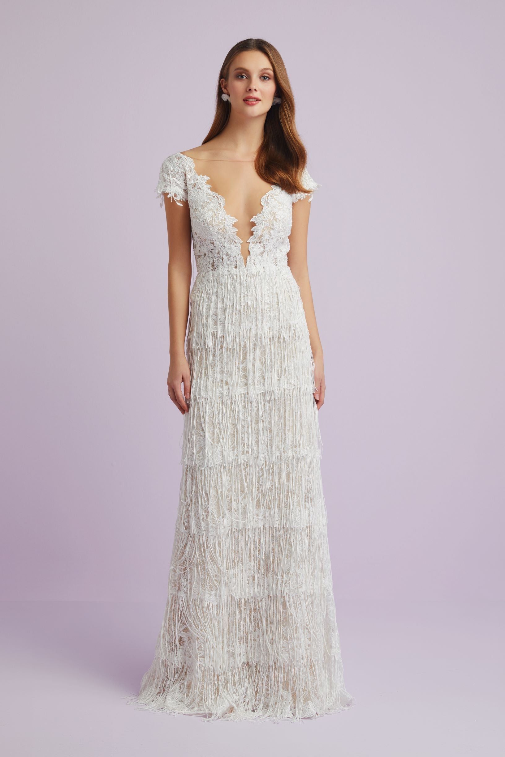 Lace gown with beaded tassel skirt