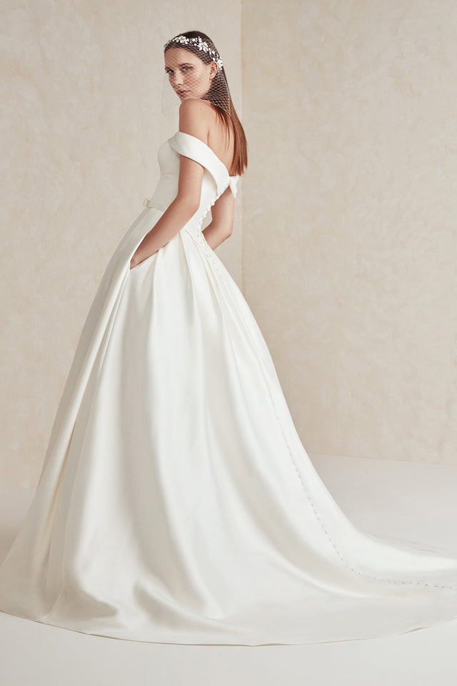 Off the shoulder ball gown with pockets and back button detail