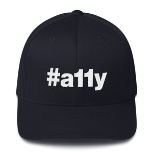 "White ""#a11y"" letters on front of dark navy blue full-back baseball cap."