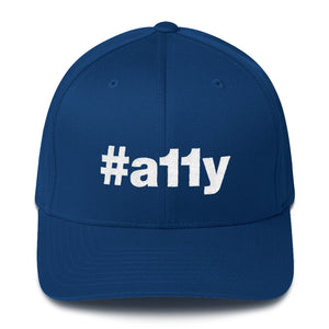 "White ""#a11y"" letters on front of royal blue full-back baseball cap."