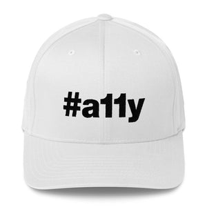 "Black ""#a11y"" letters on front of white full-back baseball cap."