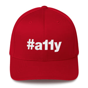 "White ""#a11y"" letters on front of red full-back baseball cap."