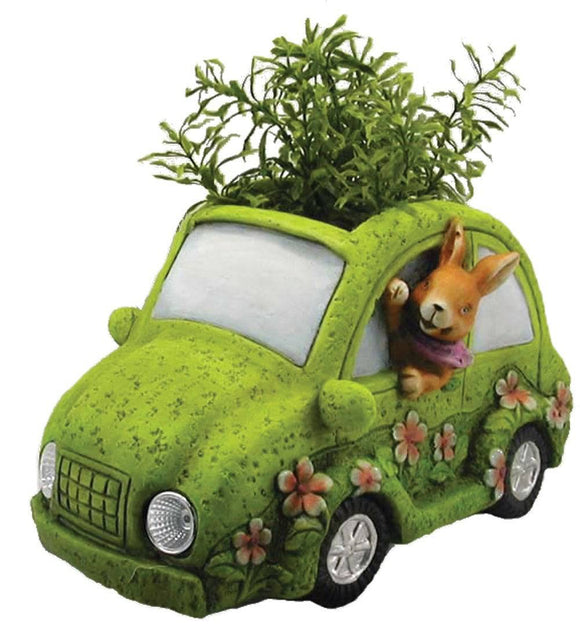 There's no cuter way to light up an outdoor space than with this adorable bunny!  A brown rabbit sits inside her car, with solar-powered headlights that will light up at night with help from the sun's rays during the day