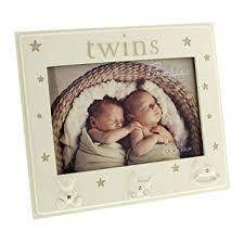 "A gorgeous 6"" x 4"" 15x10cm) resin 'twins' photo frame from Bambino. The frame features crystal finished pram, teddy bear and rocking horse icons, a pastel taupe star design and standing strut/Giftworks"