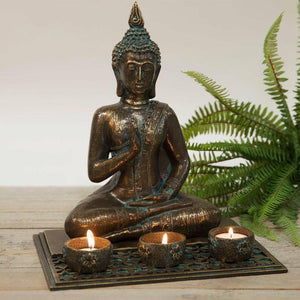 Thai Buddha Tea-Light Holder Create the perfect zen atmosphere at home with this realistic verdigris bronze effect meditating Buddha/Giftworks, Ennis&Galway