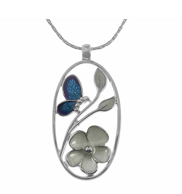 Indulgence Jewellery Necklace Sophisticated glamour is exuded with this sleek oval Pendant framing a gorgeous white flower with blue butterfly pattern/Giftworks, Ennis&Galway