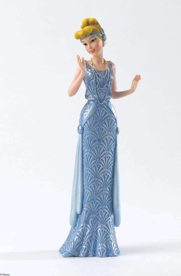 Cinderella's shimmering blue gown features iconic patterns and she wears period jewellery and head dress/Giftworks