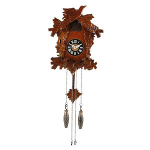 A traditional quartz cuckoo clock with an ornate, hand-carved wood design, this cuckoo clock makes a stunning focal point in any home/Giftworks, Ennis&Galway