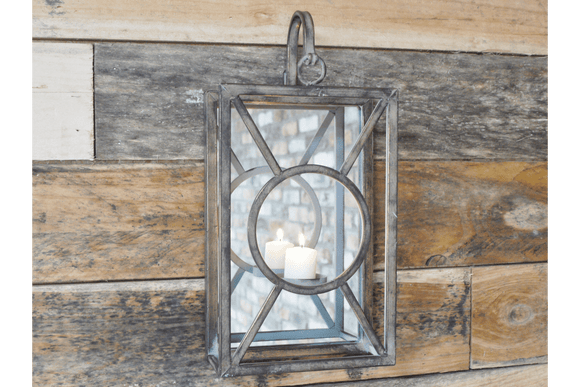 Create a warm light and a stylish feature in your home with this industrial style Silver Wall Candle Holder/Giftworks, Ennis&Galway