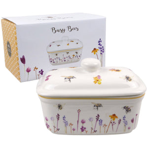 Busy Bees Butter Dish. This fun and homely Busy Bees butter dish decorated with an array of colours, the Jennifer Rose collection has captured these busy Bees hovering above beautiful wildflowers. The butter dish is made from a ceramic body which is strong and durable/Giftworks