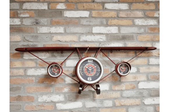 Modelled on a cargo aeroplane this clock distressed metal featuring three separate clock dials adding character to any room you decide to place it in/Giftworks, Ennis&Galway