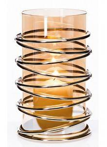 The Grange Collection Metal Candleholder. Fashioned with beautiful amber glass and gold decorative swirl accents/GIFTWORKS