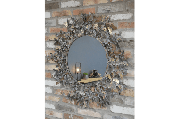 This 82cm round mirror boasts an artful arrangement of hundreds of delicate butterflies forged from high-quality steel and finished in an antique brass effect/Giftworks, Ennis&Galway
