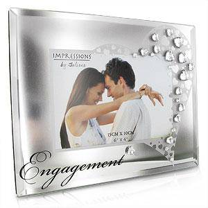 "A beautiful glass photo frame from CELEBRATIONS® with a 6"" x 4"" aperture/Giftworks, Ennis&Galway"