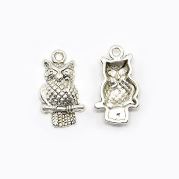 Silver owl charms showing front and back