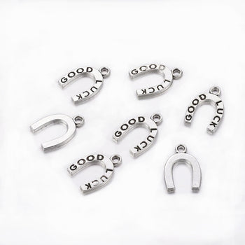 silver horseshoe charms with good luck stamped on them