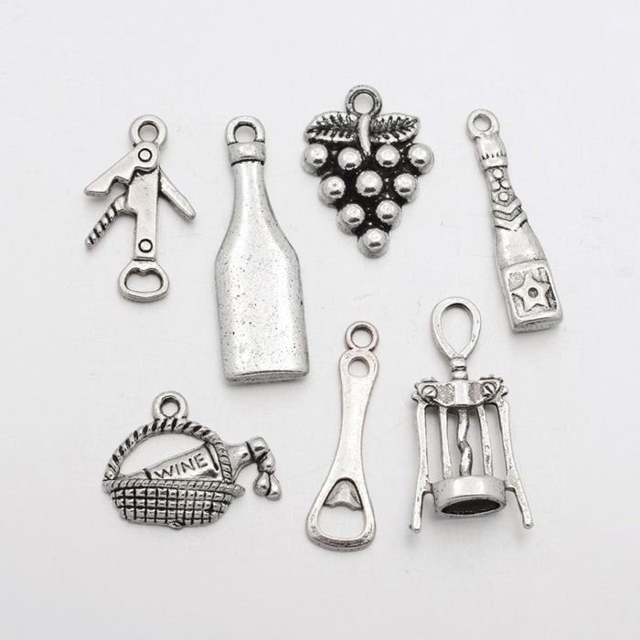 set of various jewelry charms that are wine themed