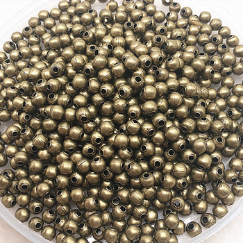 bowl of round bronze metal beads