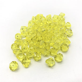 pile of yellow bicone shaped jewelry beads