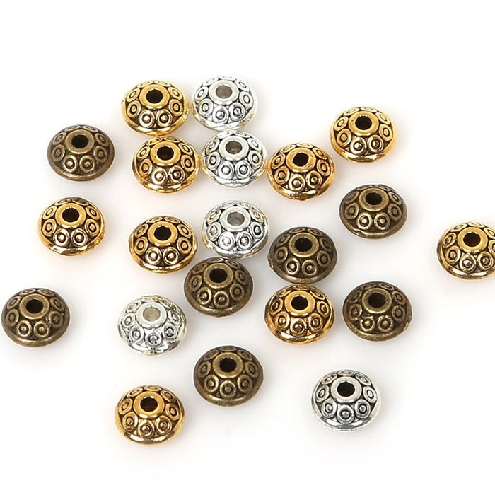bronze, silver and gold coloured metal jewelry beads