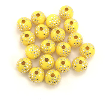 Yellow round acrylic beads with silver sparkles